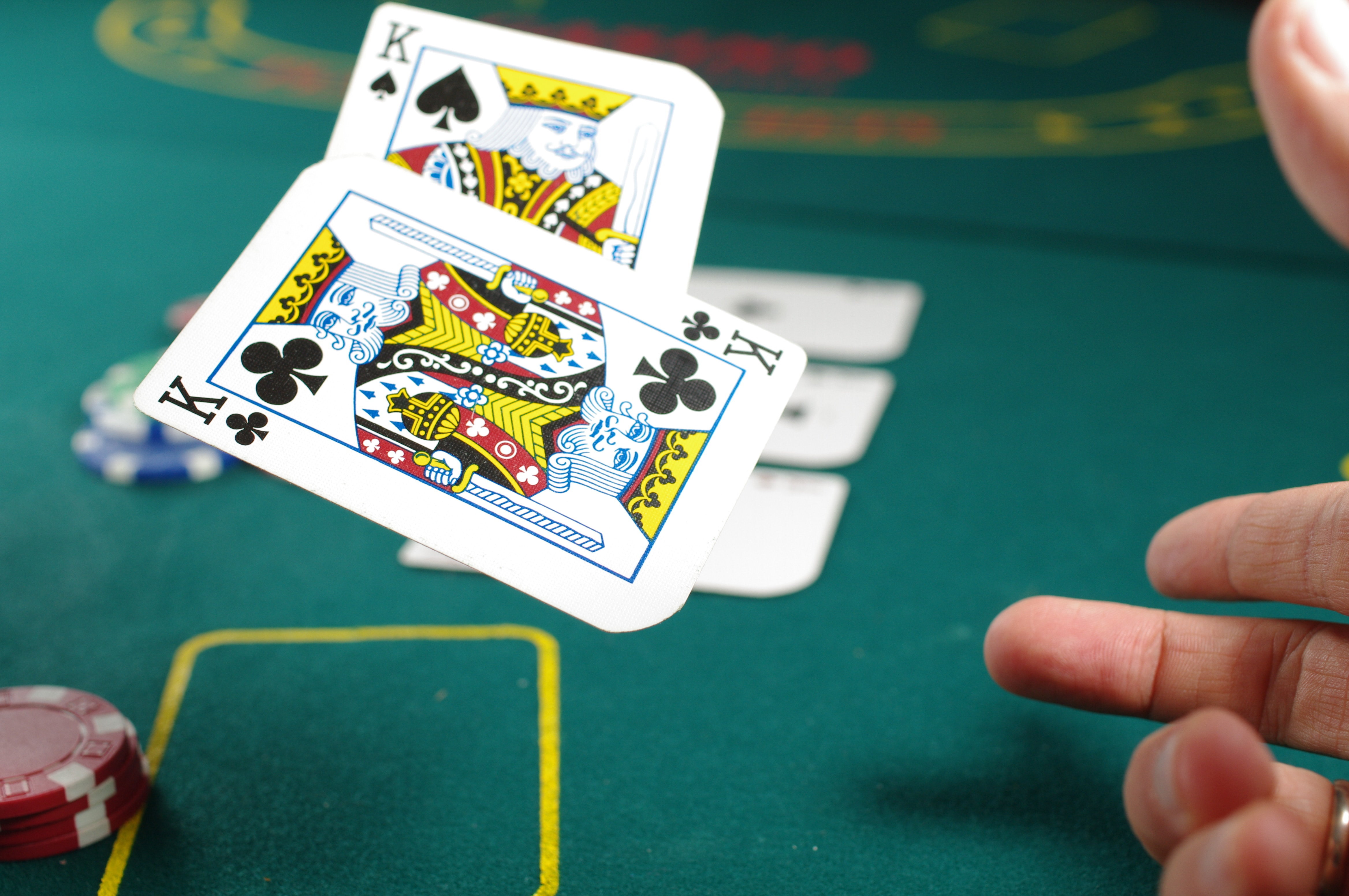is-gambling-safe-two-cards-being-thrown-onto-table